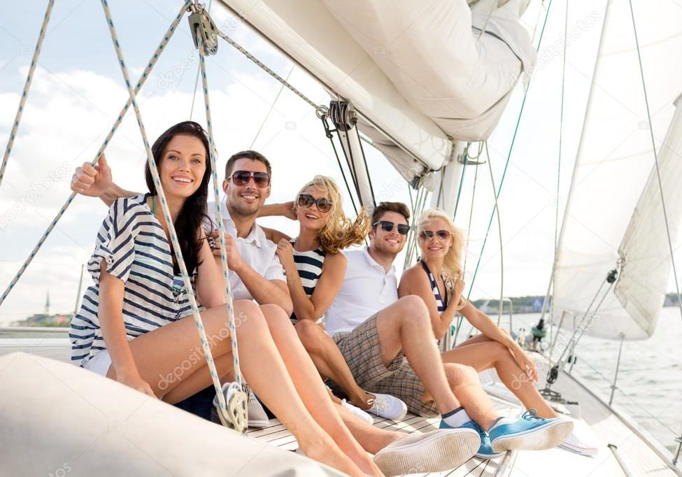 Depositphotos 50087995 Stock Photo Smiling Friends Sitting On Yacht